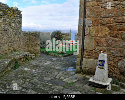 Way marker signalling the end of the 'Way of St.James' pilgrim route in the castle of San Carlos in Fisterra, Galicia. - Stock Photo