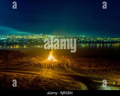 New Year's Eve Celebrations with bonfires, Reykjavik, Iceland - Stock Photo