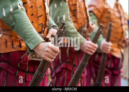 The medieval rifleman soldiers in uniform, in a row, during an historical reenactment in Florence. - Stock Photo