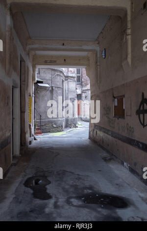 Alleyway leading into a courtyard in a ghetto tenement house in Warsaw - Stock Photo