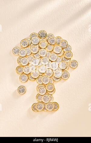 Collection of £ One Pound Coins in the Shape of a Tree - Stock Photo