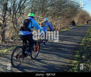 Cyclists on the tow path on the Forth and Clyde canal - Stock Photo
