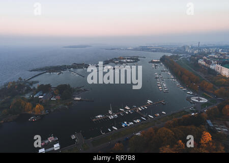 Aerial view of the islands outside Helsinki coast at Karhupuisto on an autumn day with some fog and boats at the marina. Finland - Stock Photo