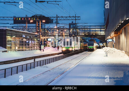 Editorial 01.18.2019 Vantaa Finland. Trains waiting to leave at the railway station in Tikkurila at winter - Stock Photo