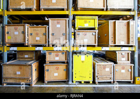 Wooden crates at shelves in museum warehouse - Stock Photo
