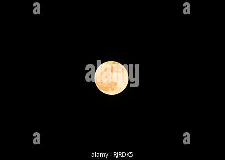 Super moon on the day of the total lunar eclipse on January 21, 2019 - Stock Photo