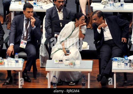 West Bengal Chief Minster Mamata Banerjee (middle) along with JSW Group Managing Director Sajjan Jindal (left) and Reliance Industries Chairman Mukesh Ambani (right) during theinauguration of Bengal Global Business Summit 2019. (Photo by Saikat Paul/Pacific Press) - Stock Photo