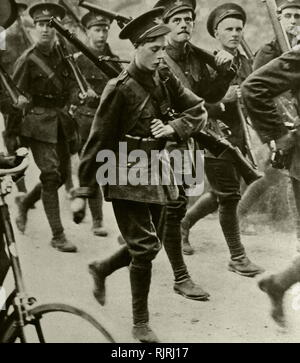 Edward Prince of Wales marches with new recruits at the outset of World War One. 1914. Edward VIII (1894 - 1972), King of the United Kingdom and the Dominions of the British Empire, and Emperor of India, from 20 January 1936 until his abdication on 11 December the same year, after which he became the Duke of Windsor. In 1936, a constitutional crisis in the British Empire arose when King-Emperor Edward VIII proposed to marry Wallis Simpson, an American socialite who was divorced from her first husband and was pursuing the divorce of her second. At Fort Belvedere, on 10 December, Edward signed h - Stock Photo