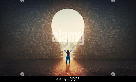 Confident woman raising hands feel free standing alone in front of a light bulb hole as a huge gate shaped in a concrete wall with a view to the city. - Stock Photo