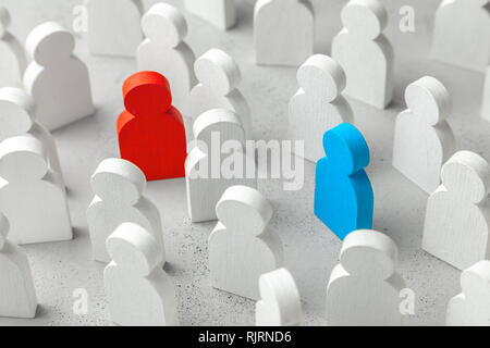 Love search concept. The concept of finding business partner. Crowd of white people and two people a red woman and blue man. - Stock Photo