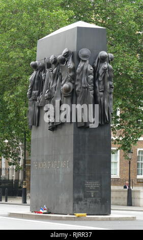 Monument to the Women of World War II is a British national war memorial situated on Whitehall in London, to the north of the Cenotaph. It was sculpted by John W. Mills, unveiled by Queen Elizabeth II and dedicated by Baroness Boothroyd in July 2005 - Stock Photo
