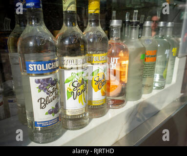 A selection of bottles of top shelf liquor displayed in the window of a bar in Midtown Manhattan in New York on Sunday, February 3, 2019.  (© Richard B. Levine) - Stock Photo
