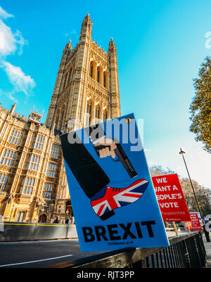London, UK - Feb 7, 2019: Anti-Brexit placard outside, Westminster, London, UK depicting Brexit as shooting the UK in the foot Credit: Alexandre Rotenberg/Alamy Live News - Stock Photo