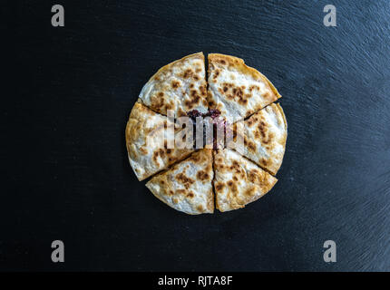 Traditional Turkish Borek Patty Pastry Food isolated on dark background. - Stock Photo