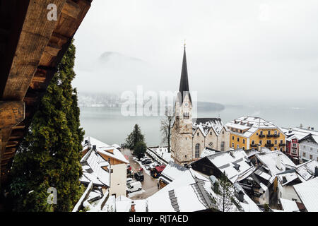 HALLSTATT, AUSTRIA - JANUARY 2019: view over Evangelische Pfarrkirche and old town at the lake front in winter. - Stock Photo