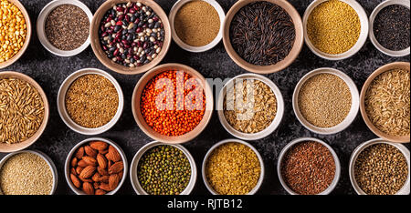 Set of different superfoods- whole grains, beans and legumes, seeds and nuts, top view. - Stock Photo