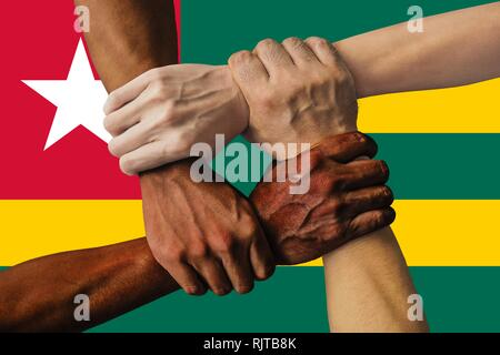 togo flag, intergration of a multicultural group of young people. - Stock Photo