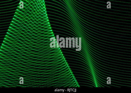 Abstract curved lines of green colors. Concept of renewable or green energy. Abstract art with lights
