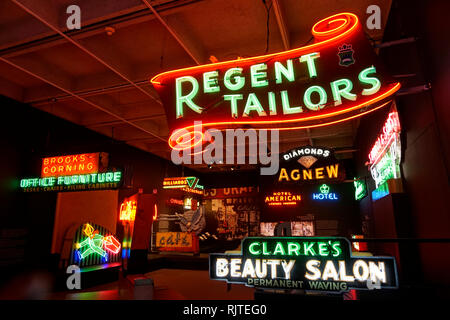 Vintage neon signs in the Ugly Vancouver gallery at the Museum of Vancouver, British Columbia, Canada - Stock Photo