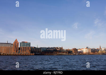 View across the river Elbe to the old city warehouses in the Port of Hamburg, St. Pauli Fischmarkt, Hamburg, Germany, Europe - Stock Photo