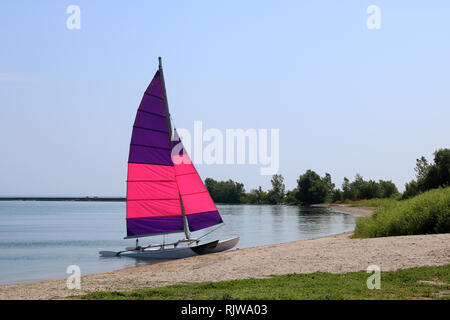 Small sail boat on Lake Ontario - Stock Photo