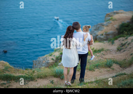 Couple family traveling together on cliff edge man and woman lifestyle concept summer vacations outdoor Crimean mountain top - Stock Photo