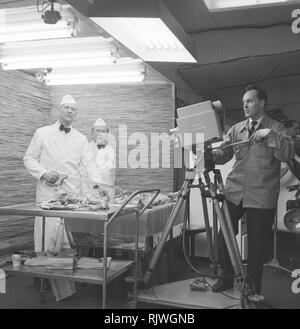 Television in the 1950s. An early television recording from an food exhibition in Stockholm February 1953. - Stock Photo