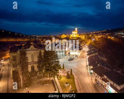 Drone aerial night view on Veliko Tarnovo. Cityscape from hill Tsarevets. - Image - Stock Photo