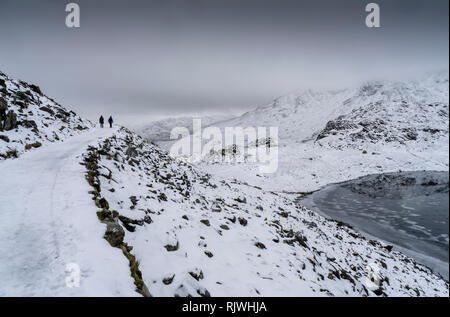 Views along the Miner's Track towards the summit of Y Wyddfa (Snowdon) on a snowy, Winter's day. - Stock Photo
