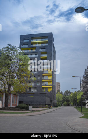 a new build in Warsaw of flats with a yellow theme - Stock Photo