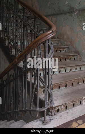 Wooden staircase in a tenement house - Stock Photo