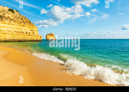 Waves lapping at sandy beach, Praia da Marinha, Algarve, Portugal, Europe - Stock Photo