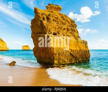 Sandstone sea stack in sunlight, Praia da Marinha, Algarve, Portugal, Europe - Stock Photo