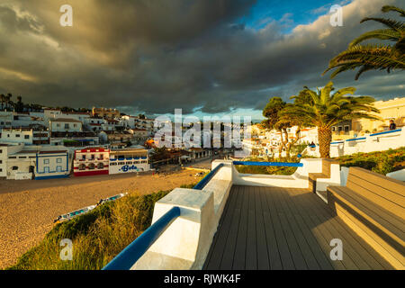Stormy sky over coastal town of Carvoeiro, Algarve, Portugal, Europe - Stock Photo