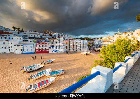 Boats on sandy beach by village of Carvoeiro, Algarve, Portugal, Europe - Stock Photo