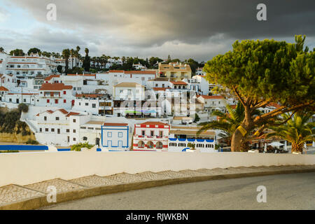 View of colourful buildings from roadside, Carvoeiro, Algarve, Portugal, Europe - Stock Photo