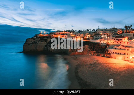 Coastal town of Carvoeiro at dusk, Algarve, Portugal, Europe - Stock Photo