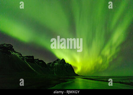 Northern Lights over Vestrahorn Mountain at Stokksnes peninsula in Southeast Iceland - Stock Photo