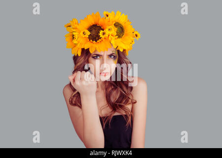displeased Woman with floral headband showing fist in anger - Stock Photo