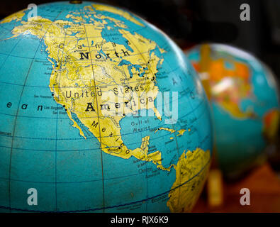 Vintage world globe showing North America for sale at an antique shop - Stock Photo