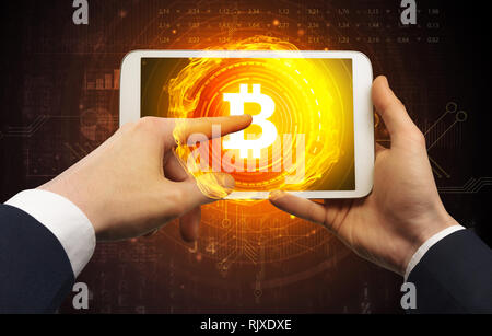 Elegant hand touching tablet with cryptocurrency concept  - Stock Photo