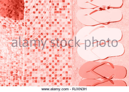 429067960 ... year 2019 · Background with flip flops at the pool edge Horizontal. Living  coral theme - color of