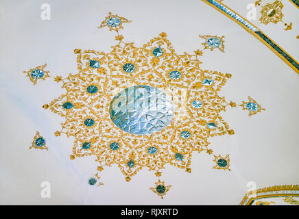 ISFAHAN, IRAN - OCTOBER 19, 2017: The rosette with the mixture of various Persian decorative styles, such as painted pattern with inlaid of small piec - Stock Photo