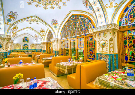 ISFAHAN, IRAN - OCTOBER 19, 2017: The Baastan restaurant combines popular Persian decorative styles, such as mirror work elements, painted ornaments,  - Stock Photo
