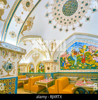 ISFAHAN, IRAN - OCTOBER 19, 2017: The beautifully decorated interior of Baastan restaurant in combination of mirrorwork, painted patterns and pictures - Stock Photo