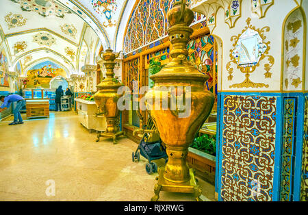 ISFAHAN, IRAN - OCTOBER 19, 2017: The beautiful interior of luxury Baastan restaurant, decorated with two huge metal samovars, on October 19 in Isfaha - Stock Photo