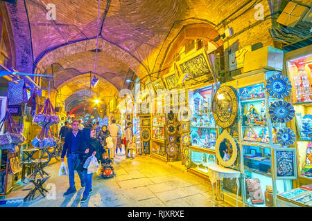 ISFAHAN, IRAN - OCTOBER 19, 2017: The Grand Bazaar is the largest and one of the most interesting markets in Iran, with thousands of stalls and shops  - Stock Photo