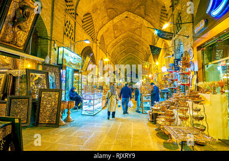 ISFAHAN, IRAN - OCTOBER 19, 2017: The blacksmith department of the Grand Bazaar with variety of copper dishes, metalwork chasings, and other decoratio - Stock Photo