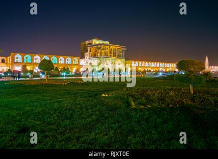 The beautiful night illumination of Ali Qapu Palace and the garden on Nashq-e Jahad Sqaure, Isfahan, Iran - Stock Photo