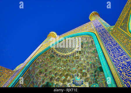 The colorful tiled muqarnas on central portal of shah Mosque with ornate floral patterns, Isfahan, Iran - Stock Photo